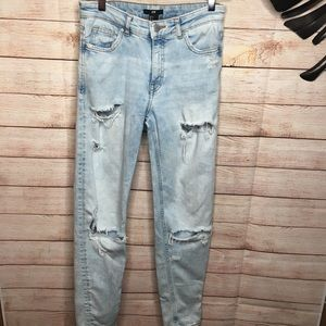 H&M wash blue high waisted distressed jeans size 2